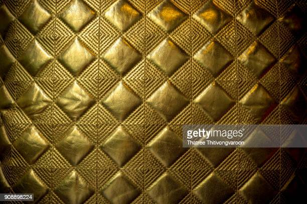 luxury golden leather close-up background - high society stock pictures, royalty-free photos & images