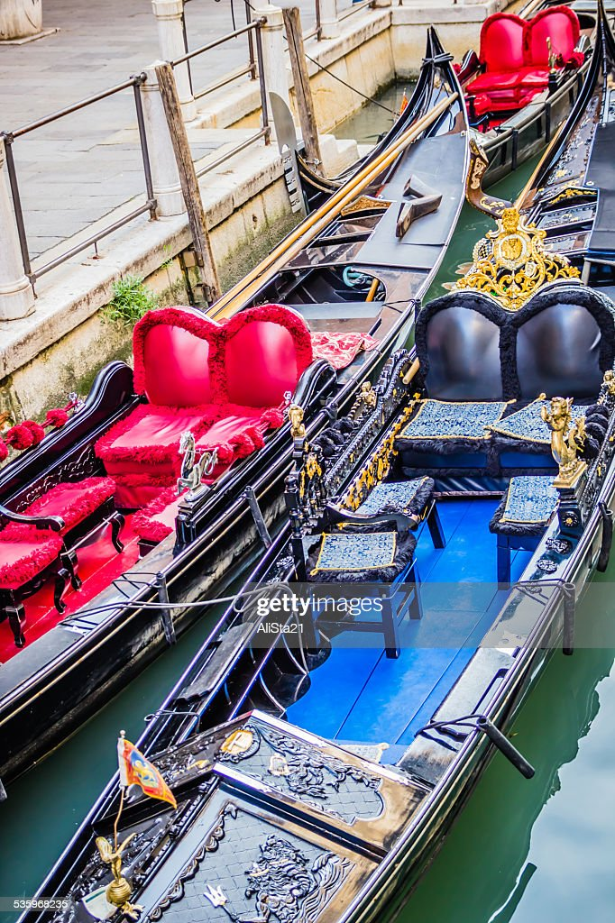 Luxury gondolas moored on water canal in Venice, Italy : Stock Photo