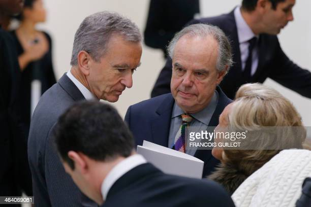 Luxury group LVMH CEO Bernard Arnault speaks with former French minister Frederic Mitterrand and former French First Lady Bernadette Chirac during...