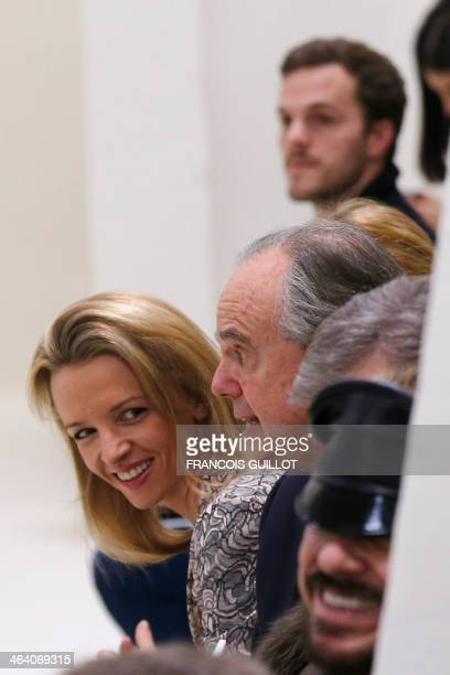 Luxury group LVMH CEO Bernard Arnault's daughter Delphine Arnault and former French minister Frederic Mitterrand attend Christian Dior Haute Couture...
