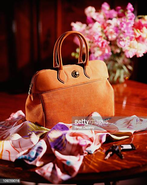 luxury hand bag on table - scarf stock pictures, royalty-free photos & images
