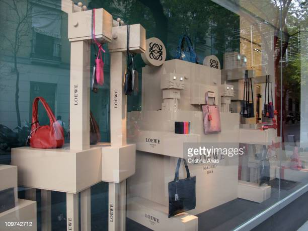 Luxury handbags and high quality leather goods in the showcase of Loewe shop for women in the Serrano street in Madrid the mark of spanish fashion...