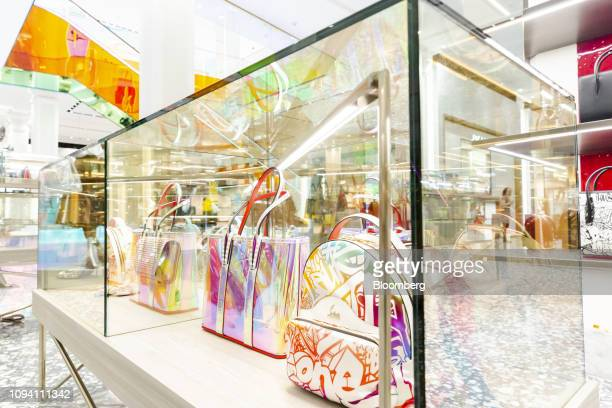 Luxury handbags sit inside a display case at the newly renovated ground floor of the Saks Fifth Avenue Inc flagship store in New York US on Monday...
