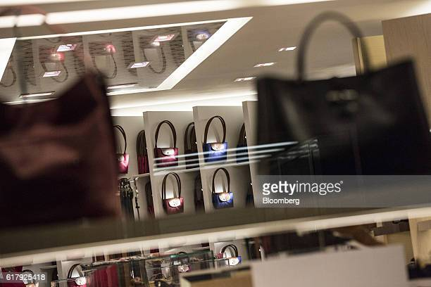 Luxury handbags sit on display inside a Longchamp SAS store in BadenBaden Germany on Monday Oct 24 2016 The world's luxurygoods market stopped...