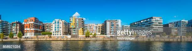 Luxury harbour waterfront apartment buildings crowds on promenade Hamburg Germany