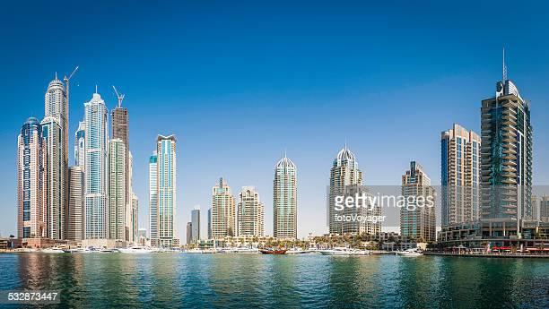 Luxury highrise apartments soaring into blue sky above Dubai Marina