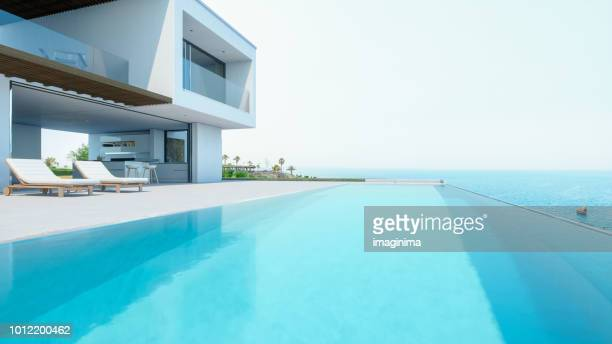 luxury holiday villa with infinity pool - tourist resort stock pictures, royalty-free photos & images