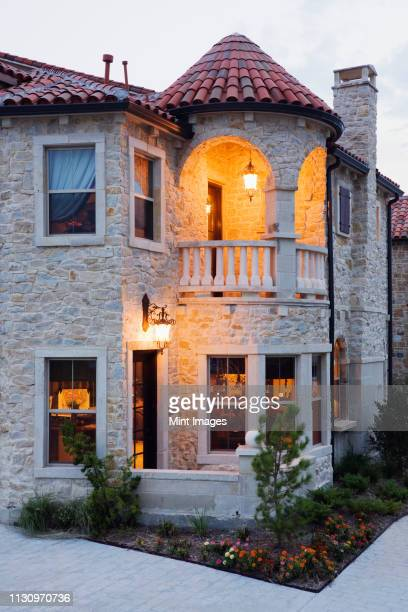 luxury home at dusk - stone house stock pictures, royalty-free photos & images