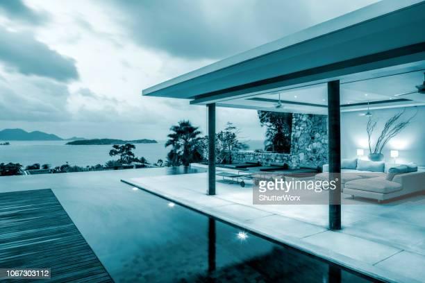 Luxury Home Island Villa On An Island Along The Coastline At Twilight