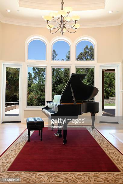 luxury home with grand piano - grand piano stock photos and pictures