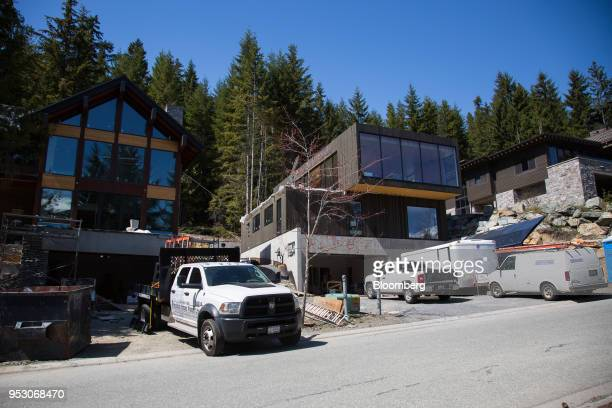 Luxury homes stand under construction on Treetop Lane in Whistler British Columbia Canada on Friday April 27 2018 The cost of a typical home in...