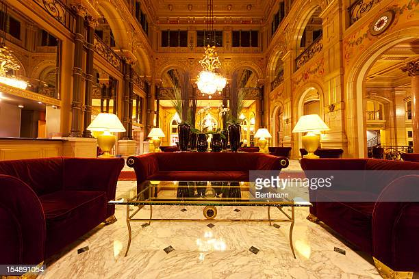 luxury hotel lobby with columns - hotel lobby stock pictures, royalty-free photos & images
