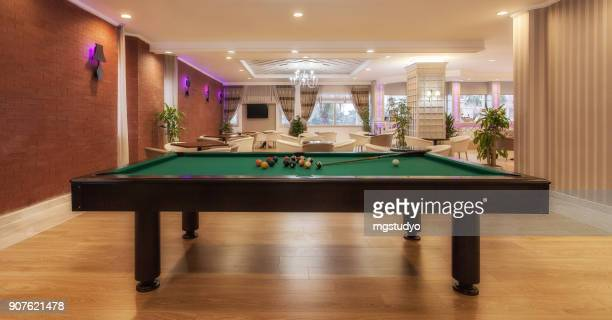 Luxury hotel lobby with pool table