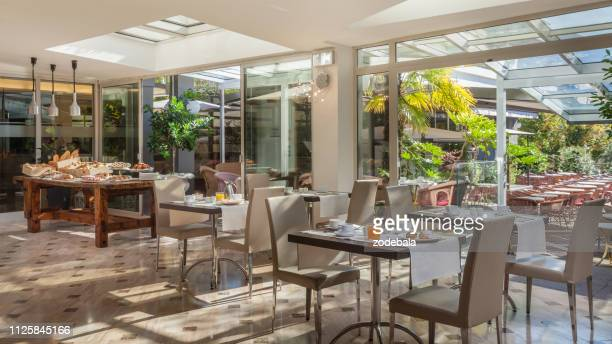 luxury hotel restaurant table and chairs setting - hotel breakfast stock pictures, royalty-free photos & images
