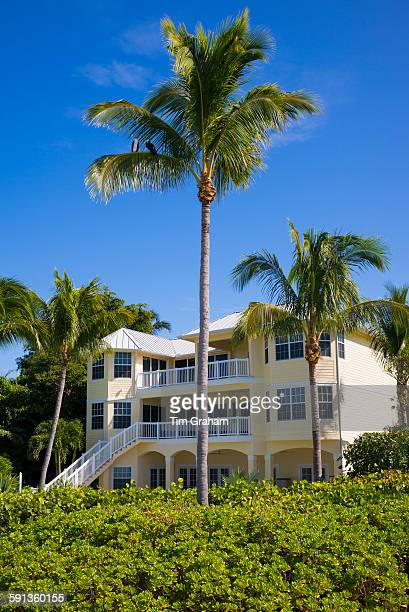 Luxury hotel surrounded by palm trees at upmarket South Seas Island Resort on Captiva Island in subtropical Florida USA