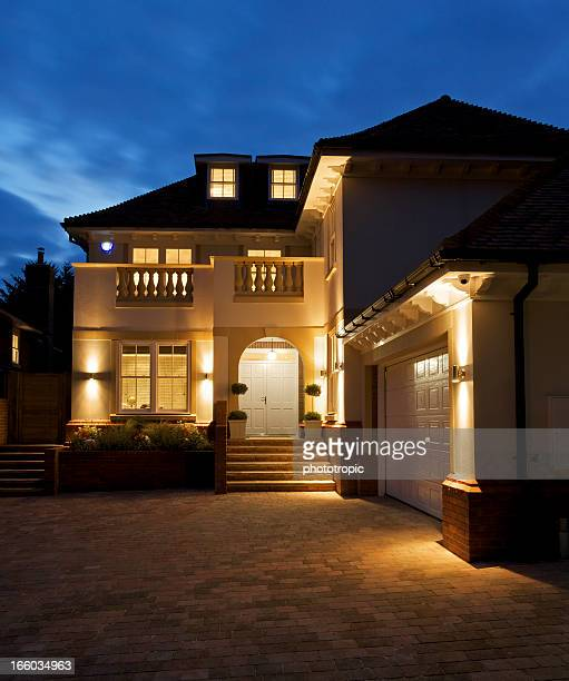 luxury house at night - illuminate stock photos and pictures