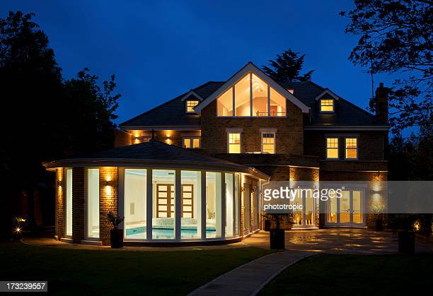 luxury house with pool at dusk