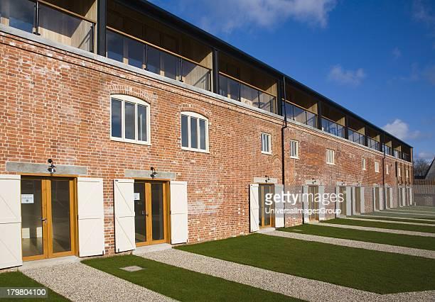 Luxury housing development of Iken View in former industrial buildings at Snape Maltings Suffolk England