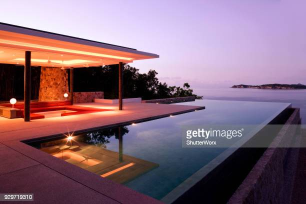 luxury island villa home in the tropics along the coastline at sunrise - gazebo stock pictures, royalty-free photos & images
