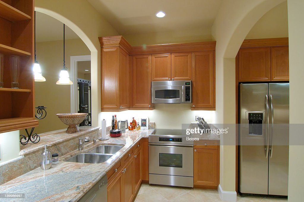 Luxury Kitchen With Stainless Steel Appliances Stock Photo