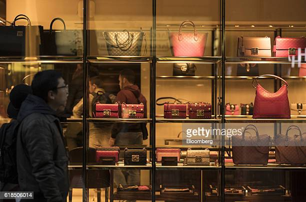 Luxury leather handbags sit in the window display of a Gucci highend goods boutique operated by Kering SA in Frankfurt Germany on Wednesday Oct 26...