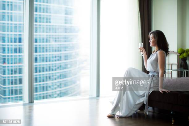 luxury life - women of penthouse stock photos and pictures