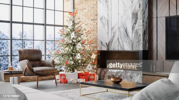 luxury living room with fireplace and christmas decoration - chalet stock pictures, royalty-free photos & images