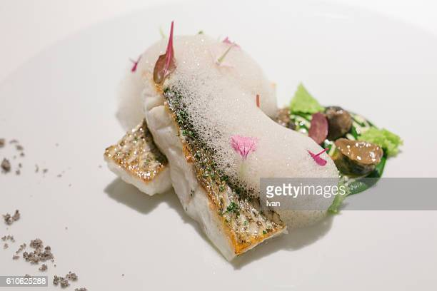 luxury molecular gastronomy, cooked european sea bass with vegetable foams and bubbles sauce - linguado da areia imagens e fotografias de stock