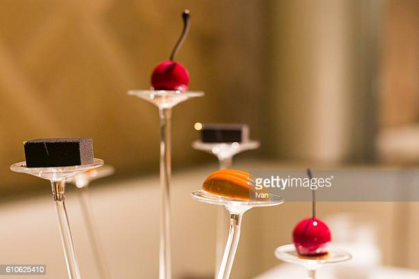 Luxury Molecular Gastronomy Dessert, Almond Caramel Chocolate, Cherry Candy and Sesame Cookie