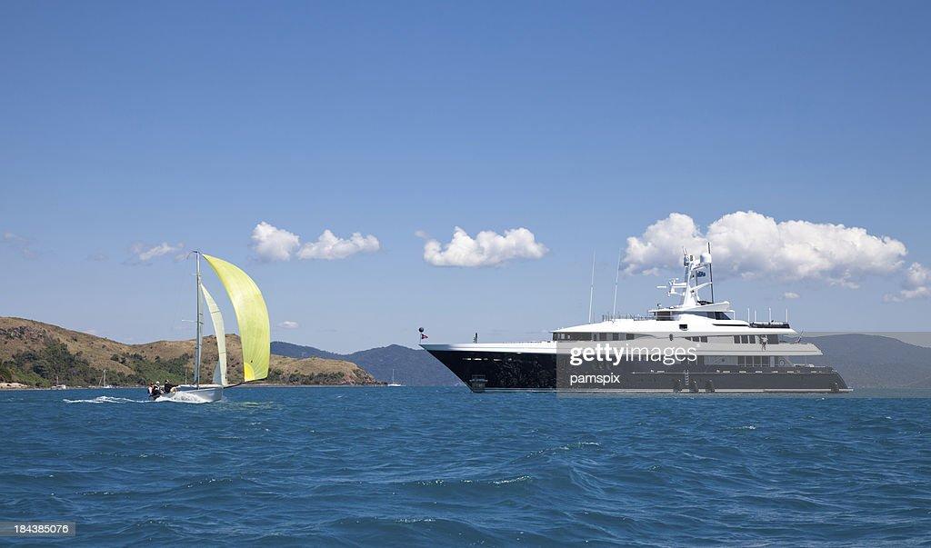 Luxury Motor Yacht and Sailing Boat at Sea : Stock Photo