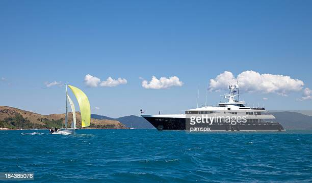 luxury motor yacht and sailing boat at sea - small boat stock pictures, royalty-free photos & images