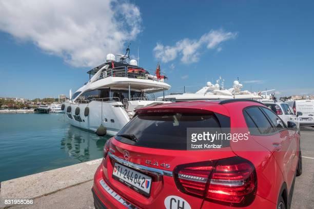 Luxury motoryacht and car at Port Vaubani Antibes port, Alpes Maritimes, France