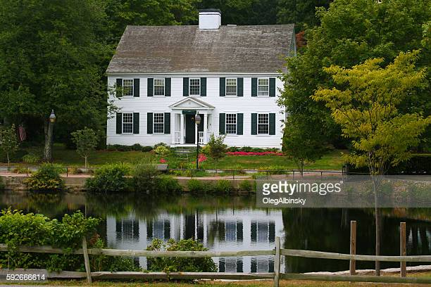 luxury new england house on a pond among trees, massachusetts. - colonial style stock pictures, royalty-free photos & images
