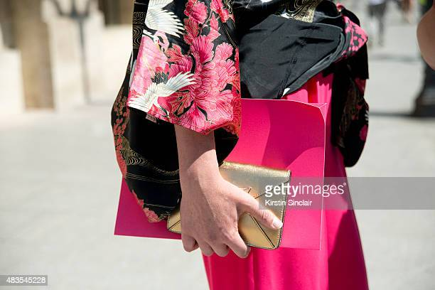 Luxury PR consultant Lorena Vergani wears a Japanese kimono and Catjaurin souver trousers on day 2 of Paris Fashion Week Haute Couture Autumn/Winter...