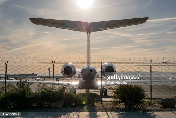 las vegas, usa - april 15, 2019: luxury private jet parked at mccarran airport during sunset - taxiing stock pictures, royalty-free photos & images