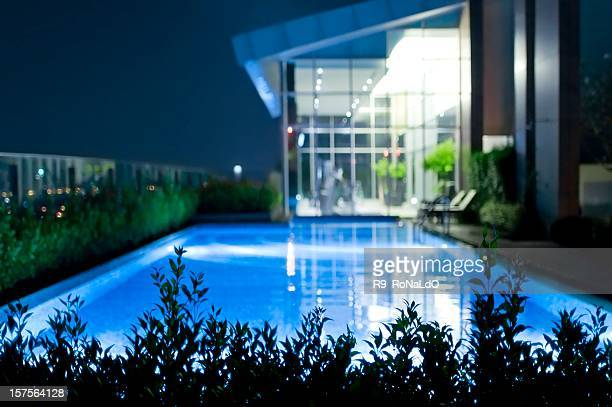 Luxury private swimming pool in mansion at night