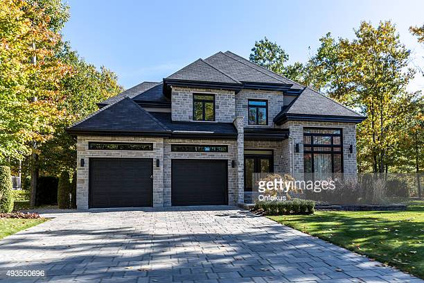 luxury property on sunny day of autumn - house stock pictures, royalty-free photos & images