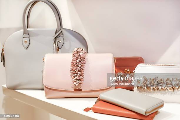 luxury purses on display - clutch bag stock pictures, royalty-free photos & images