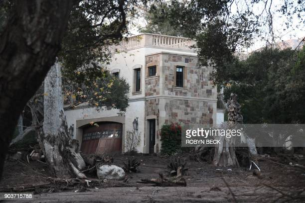 A luxury residence is surrounded by mud and debris caused by a massive mudflow in Montecito California January 10 2018 Search and rescue efforts...