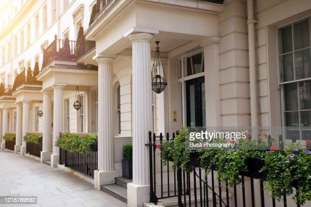 luxury residential properties along grosvenor crescent in london's belgravia district, one of the uk's most expensive residential streets. london, england - real estate stock pictures, royalty-free photos & images