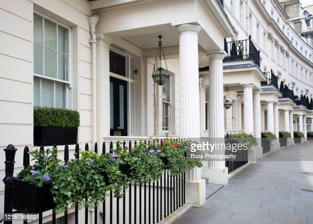 luxury residential properties along grosvenor crescent in london's belgravia district, one of the uk's most expensive residential streets. london, england - city of westminster london stock pictures, royalty-free photos & images