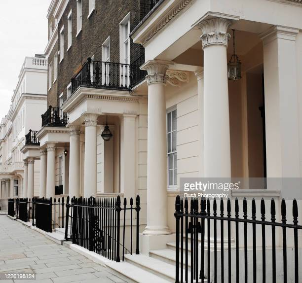 luxury residential properties along grosvenor crescent in london's belgravia district, one of the uk's most expensive residential streets. london, england - residential district stock pictures, royalty-free photos & images