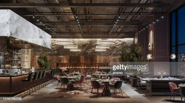luxury restaurant interior at night - restaurant stock pictures, royalty-free photos & images