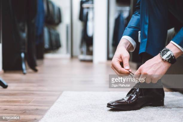 luxury retail store - men fashion stock photos and pictures