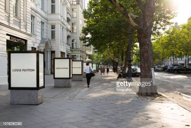 luxury retail stores at kurfürstendamm at a sunny summer day - kurfürstendamm stock pictures, royalty-free photos & images