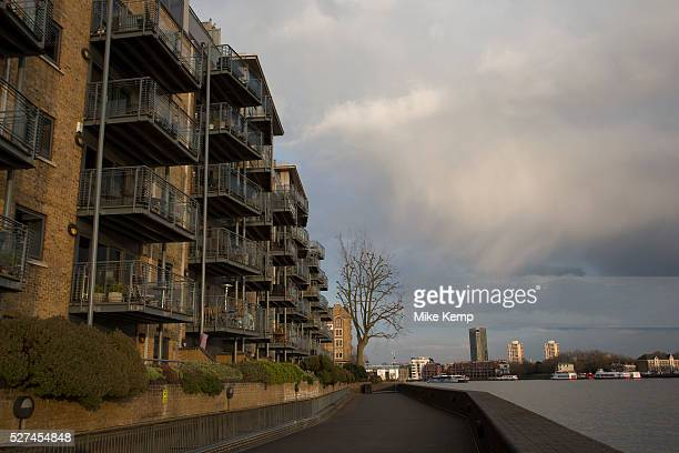 Luxury riverside flats in Wapping London UK Wharf buildings on Wapping High Street by the River Thames London UK This is the famous street which once...
