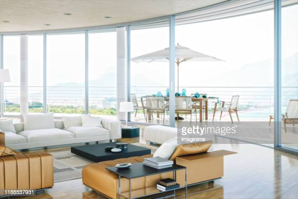 luxury rooftop living room with ocean view - penthouse stock pictures, royalty-free photos & images
