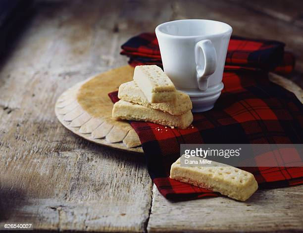 luxury scottish all butter shortbread fingers on tartan tea towel - scottish culture stock pictures, royalty-free photos & images
