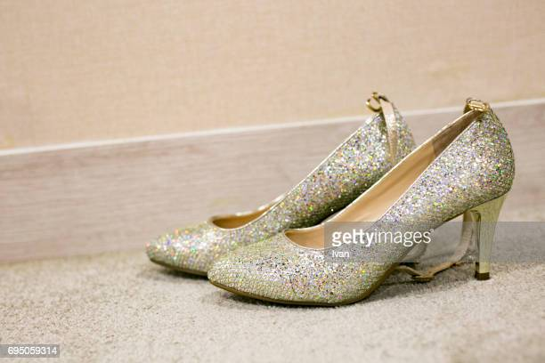 Luxury Shinny High Heel Shoes puts near the Wall