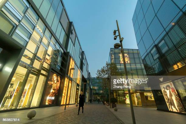 Luxury shops are lined on the Sanlitun commercial street which is the fashion landmark of Beijing